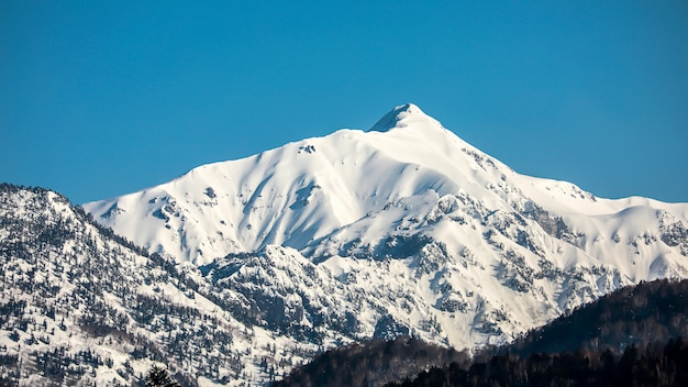 Landscape of the snow mountain with blue sky at japan alps mountain.