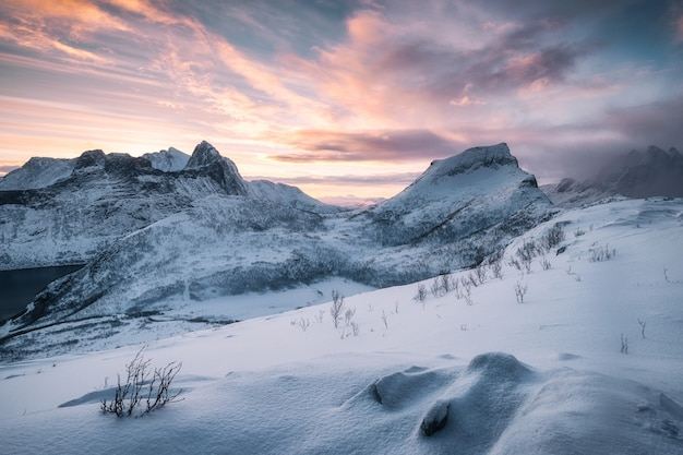 Landscape of snowy mountain with colorful sky at sunrise