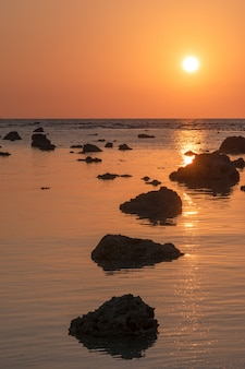 Landscape sunset at cape coral  in the andaman sea at phang nga,southern of thailand