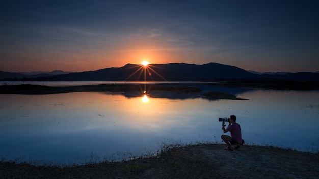 Landscape of sunset and photographer