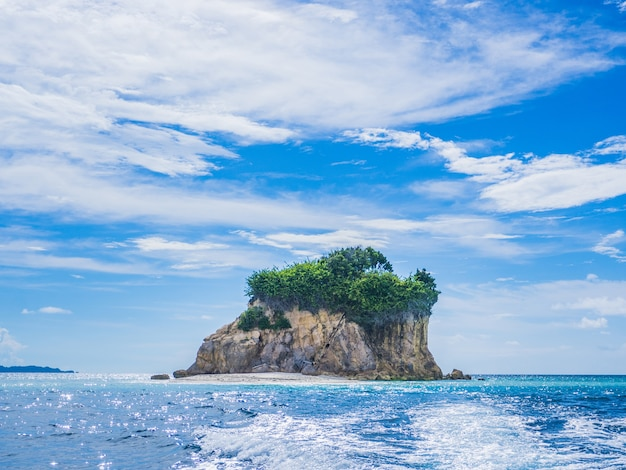 Landscape of turquoise sea with cloudy sky and wonderful island shape.