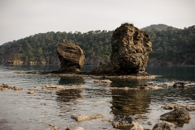 Landscape of the two big rocks on the sea in the day time