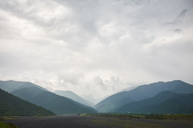 Landscape of a valley of a mountain valley, mountains background mountain river, georgia, caucasus