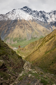 Landscape of a valley of a mountain valley, mountains with snow-capped peaks
