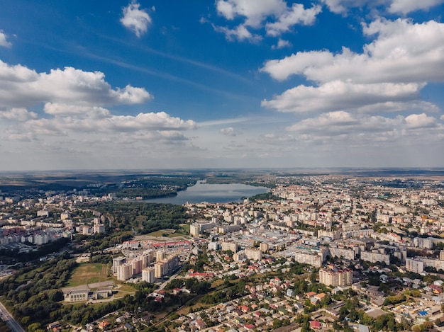 Landscape view over city on summer sunny day with clouds aerial and view to lake