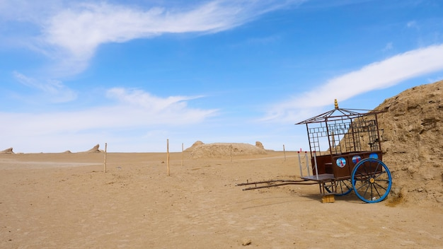 Landscape view of dachaidan wusute water yadan geological park and retro cart in qinghai china