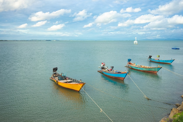 Landscape of view the fishing harbor sunset latinos there is a boat landing. in a fishing village in rayong,