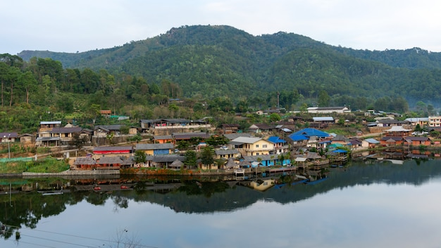 Landscape view with reflexion in the lake at ban rak thai village in mae hong son thailand.