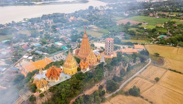 Landscape of wat tham suea, kanchanaburi thailand with smoke from burning rice stubble