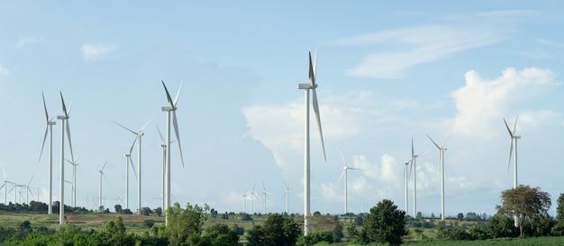 Landscape of wind turbine against blue sky.