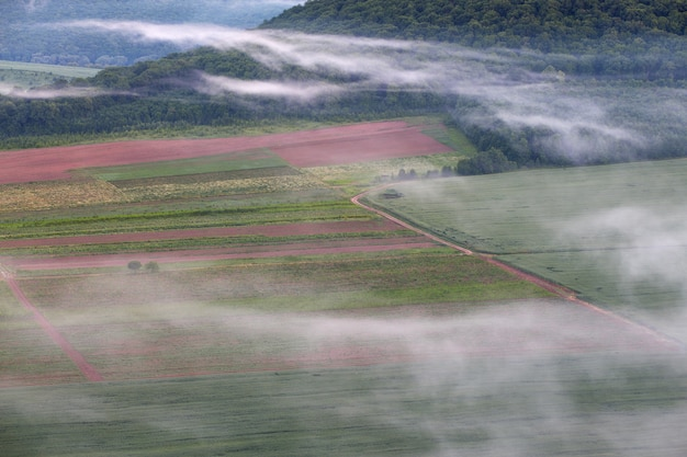 Landscape with a bird's eye view. fields road and fog