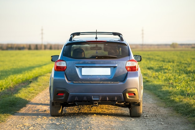 Landscape with blue off road car on gravel road. traveling by auto, adventure in wildlife