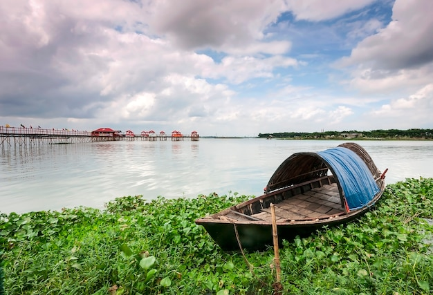 Landscape with boat in bangladesh. lakes and rivers. background