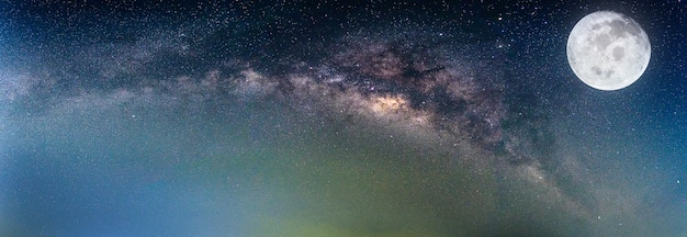Landscape with milky way galaxy and the full moon. (elements of this moon image furnished