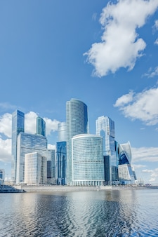 Landscape with a view of moscow city of skyscrapers in the summer time under a blue sky