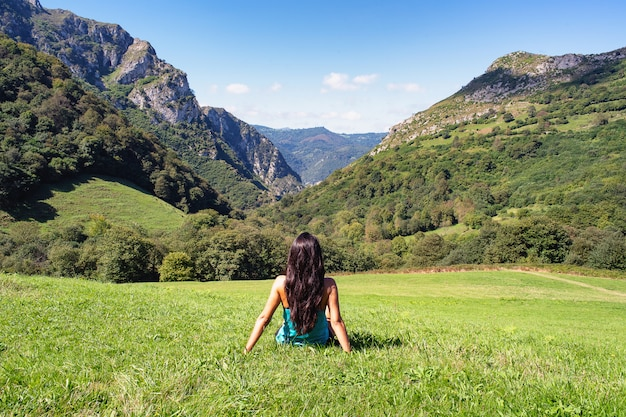Landscape of woman in mountains of asturias, spain