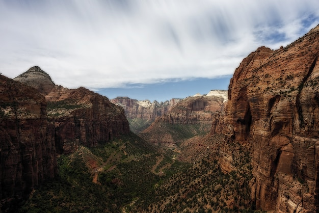 Landscape of the zion national park under the sunlight and a cloudy sky in utah