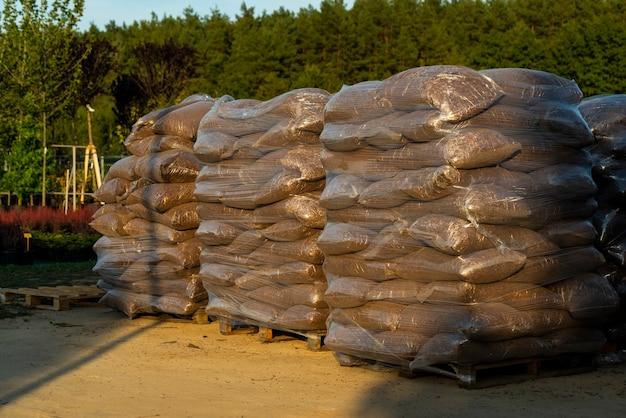 Landscaped oak bark in bags for sale outdoors