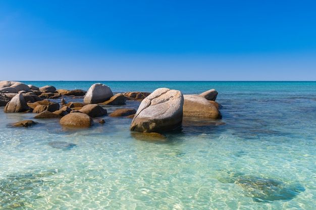 Lanscape view of white stones in blue sea.