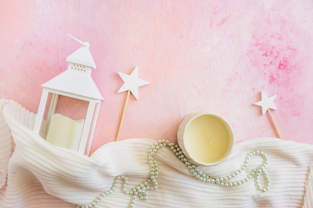Lantern and candle on pink