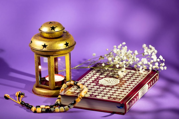 Lantern and quran with purple background
