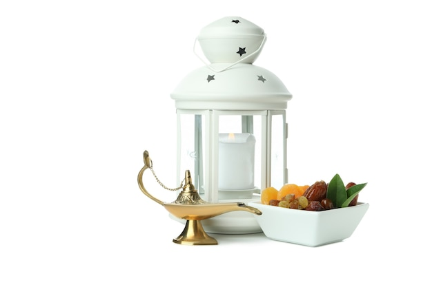 Lantern, ramadan lamp and dried fruits isolated on white