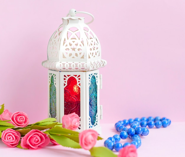 Lantern with candle and rosary beads