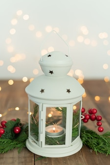 Lantern with christmas ornaments on wooden table. copy space.