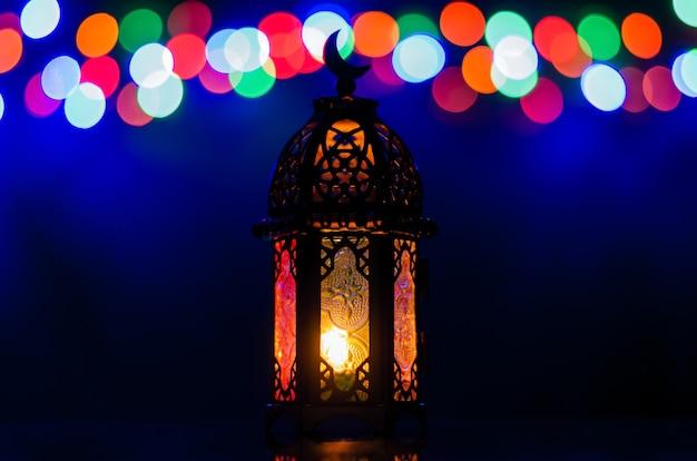 Lantern with colorful bokeh lights for islamic new year and ramadan kareem concept.