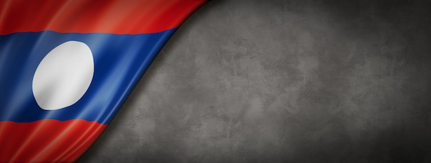 Laos flag on concrete wall. horizontal panoramic. 3d illustration