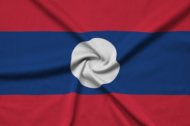 Laos flag is depicted on a sports cloth fabric with many folds.