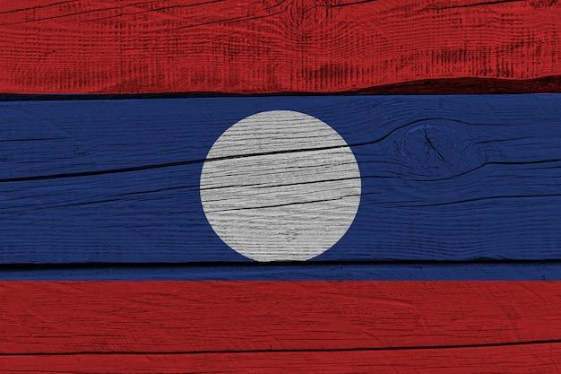 Laos flag painted on old wood plank