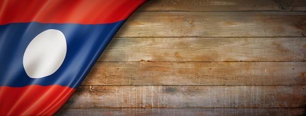 Laos flag on vintage wood wall