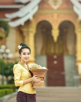Laos girls beautiful on national dress at temple