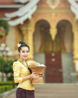 Laos girls beautiful on National dress at temple