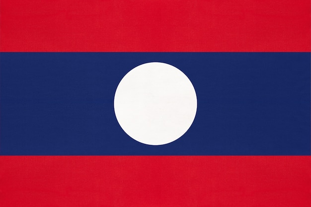 Laos national fabric flag, textile background. symbol of asian world country.