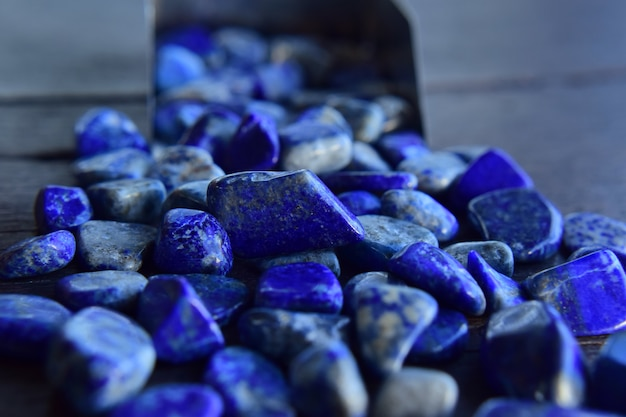 Lapis is a beautiful natural gemstone on a wooden floor