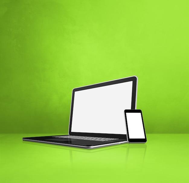 노트북 및 녹색 사무실 책상에 휴대 전화입니다. 3d 일러스트레이션
