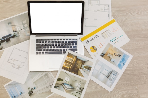 Laptop on architectural drawing paper for construction white