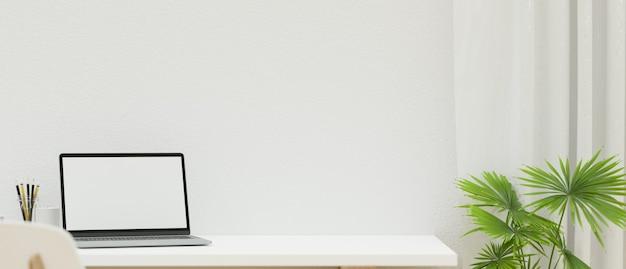 Макет пустого экрана ноутбука на рабочем столе с пространством для монтажа на белой стене 3d-рендеринга