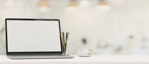 Laptop blank screen mockup on tabletop with copy space for montage over blurred background 3d