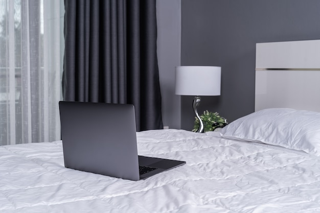 Laptop computer on a bed