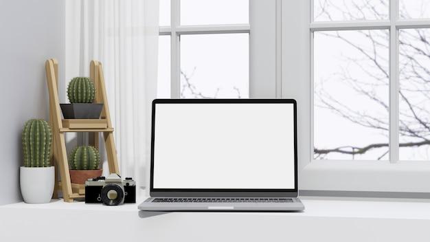 Макет портативного компьютера в белом минимальном дизайне рабочего пространства рабочий стол возле окна 3d-рендеринга