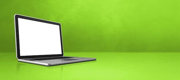 Портативный компьютер на зеленом офисе сцены баннер