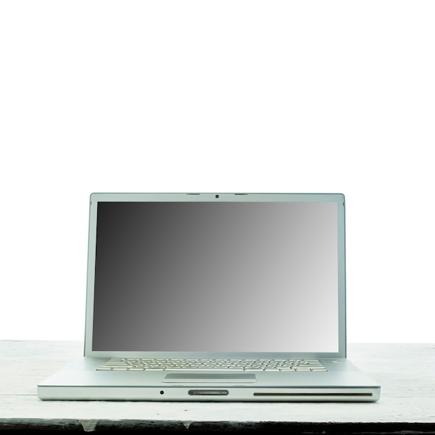 Laptop computer on white wooden texture background. work from home concept.