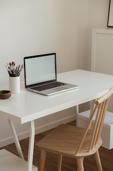 Laptop computer with blank screen on table