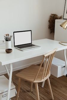 Laptop computer with blank screen on table Premium Photo