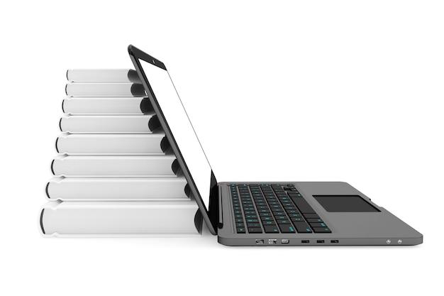 白い背景の上の本のスタックとラップトップコンピューター
