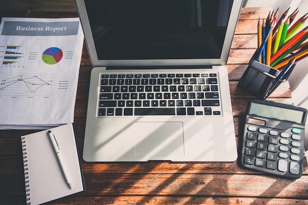 Laptop on the desk of business stylists vintage hipster.