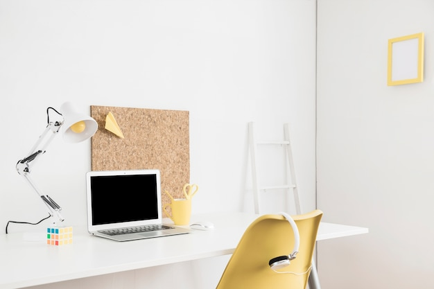 Laptop display for mockup on table in white room
